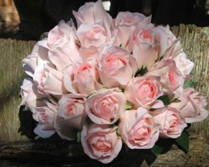 2 pink rose bouquet on fence (1).jpg
